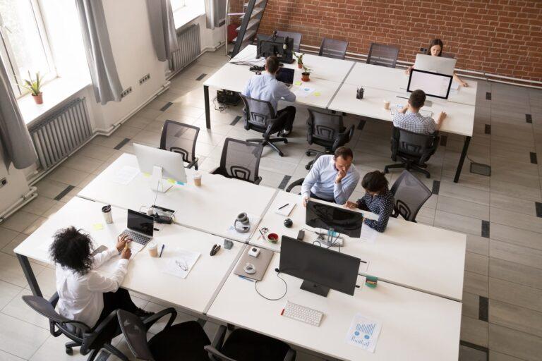 Employees Working In Modern Office